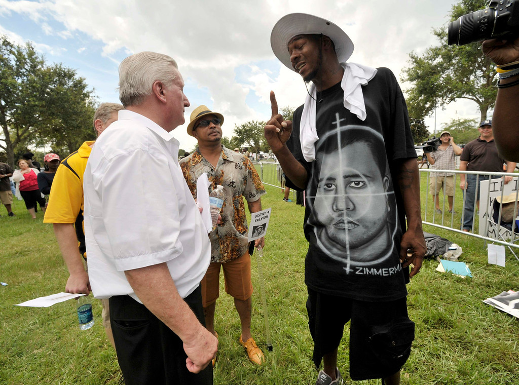 . Casey David Kole (L), a supporter of George Zimmerman argues with Ike Thomas of Sanford, FL outside Seminole County Court where George Zimmerman\'s second-degree murder trial is being deliberated by jurors in Sanford, Florida, July 13, 2013.  REUTERS/Steve Nesius