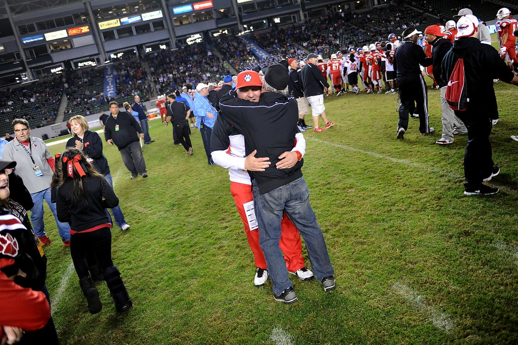 . Redlands East Valley High School head football coach Kurt Bruich hugs his father Dick Bruich after REV defeated Clayton Valley Charter 34-33 in the CIF-State Division II championship on Saturday, December 20, 2014 at StubHub Center in Carson, Ca. (Photo by Micah Escamilla/Redlands Daily Facts)