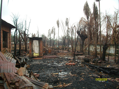 Buddhist homes, villages, and towns - burned