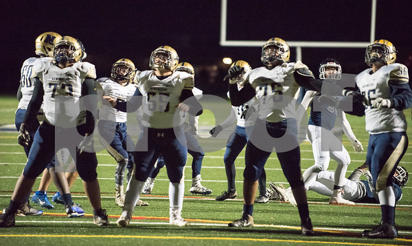 11/22/17 Wesley Bunnell | Staff Newington vs Wethersfield on Wednesday night at Wethersfield High School. Kamani Chambers (73), #55, Damon Stewart (75) and #56 watch as the field goal try is good.