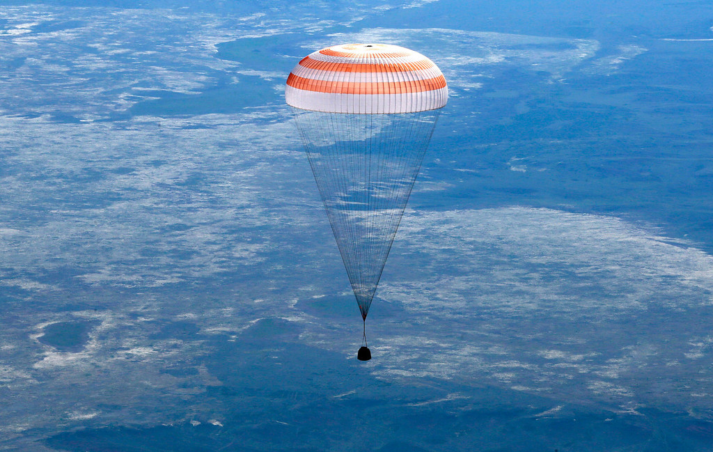 . A Russian Soyuz TMA-07M space capsule descends about 150 km (90 miles) south-east of the Kazakh town of Dzhezkazgan, Kazakhstan, Tuesday, May 14, 2013.  A Soyuz space capsule with a three-man crew returning from a five-month mission to the International Space Station landed safely Tuesday on the steppes of Kazakhstan. (AP Photo/Mikhail Metzel, Pool)