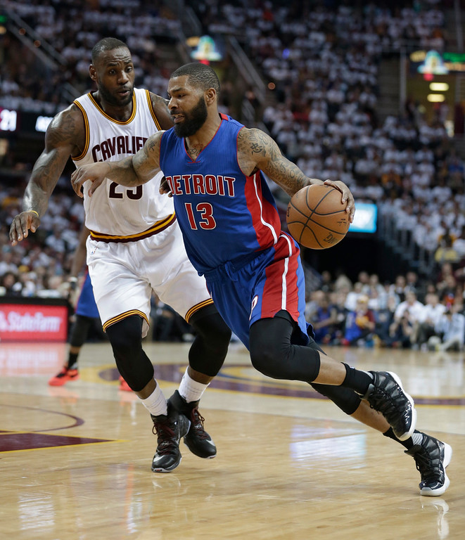 . Detroit Pistons\' Marcus Morris (13) drives past Cleveland Cavaliers\' LeBron James (23) in the second half in Game 2 of a first-round NBA basketball playoff series, Wednesday, April 20, 2016, in Cleveland. The Cavaliers won 107-90. (AP Photo/Tony Dejak)