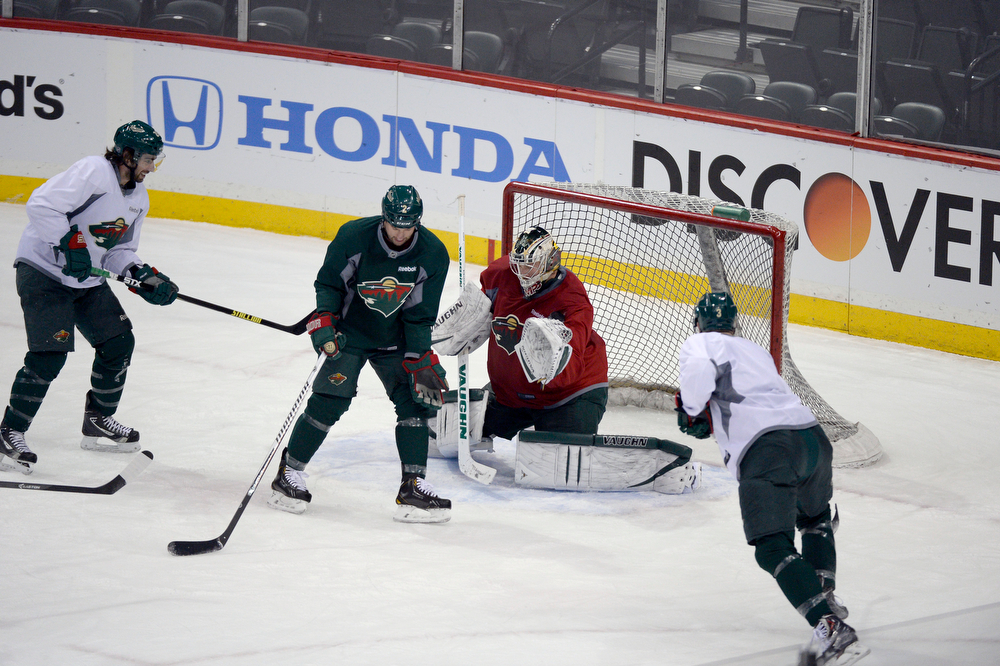 . Minnesota Wild goalie Darcy Kuemper (35) in goal during practice as Minnesota Wild defenseman Keith Ballard (2) screens in front of him April 23, 2014 at Xcel Energy Center. (Photo by John Leyba/The Denver Post)