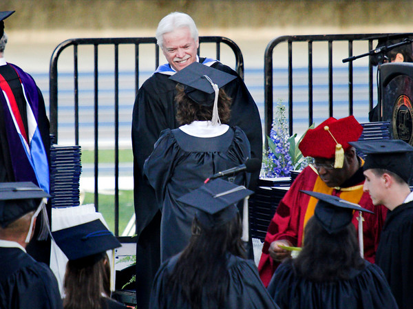 Receiving her diploma from Ted Turner.