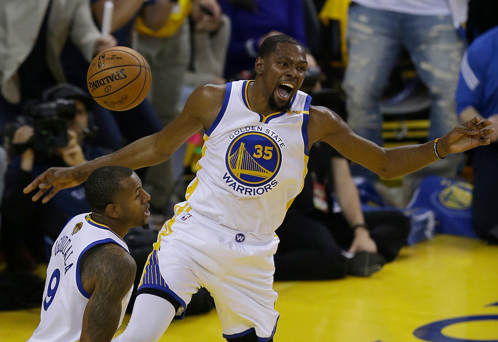 . Golden State Warriors forward Kevin Durant (35) reacts after dunking against the Cleveland Cavaliers next to forward Andre Iguodala during the first half of Game 1 of basketball\'s NBA Finals in Oakland, Calif., Thursday, June 1, 2017. (AP Photo/Ben Margot)