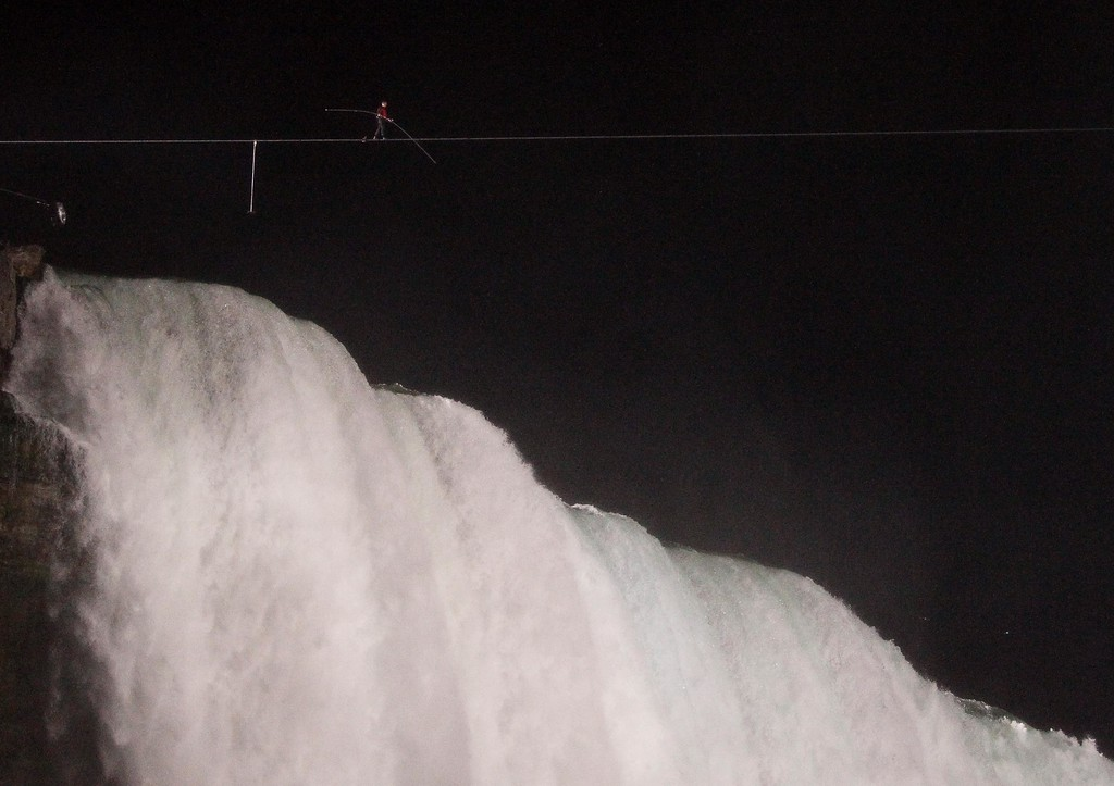 . Nik Wallenda walks across Niagara Falls on a tightrope as seen from Niagara Falls, N.Y., Friday, June 15, 2012. Wallenda has finished his attempt to become the first person to walk on a tightrope 1,800 feet across the mist-fogged brink of roaring Niagara Falls. The seventh-generation member of the famed Flying Wallendas had long dreamed of pulling off the stunt, never before attempted. (AP Photo/James P. McCoy)
