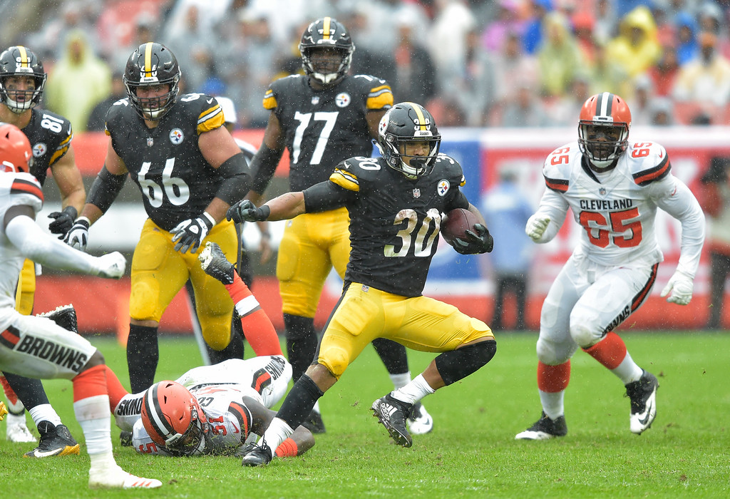 . Pittsburgh Steelers running back James Conner (30) rushes during the first half of an NFL football game against the Cleveland Browns, Sunday, Sept. 9, 2018, in Cleveland. (AP Photo/David Richard)