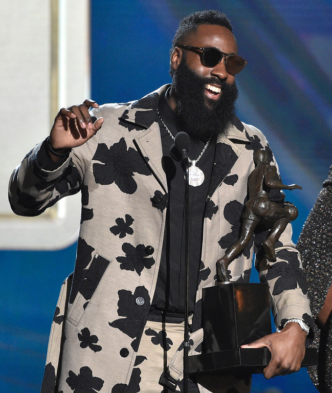 . CORRECTS SPELLING OF LAST NAME TO HARDEN, INSTEAD OF HARDIN - NBA player James Harden, of the Houston Rockets, left, accepts the most valuable player award at the NBA Awards on Monday, June 25, 2018, at the Barker Hangar in Santa Monica, Calif. (Photo by Chris Pizzello/Invision/AP)