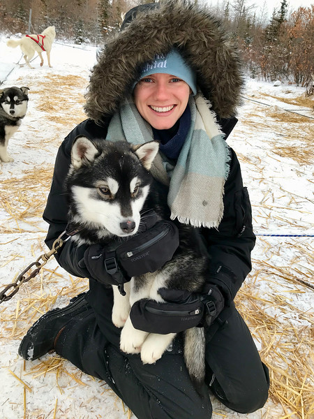 Aunika and a sled dog puppy