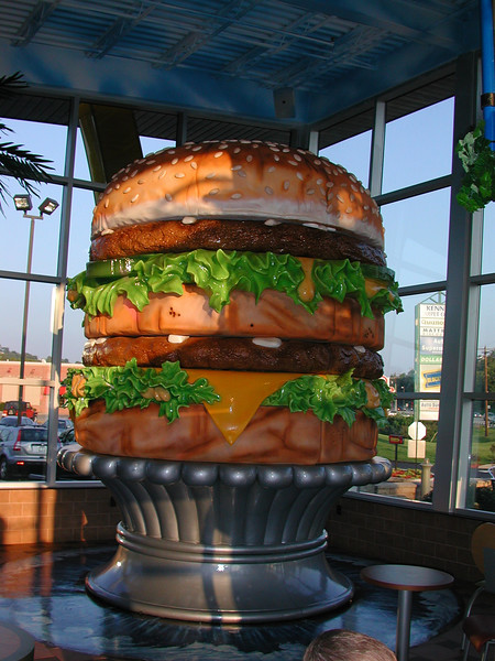 """A """"Giant Big Mac"""" greets you upon entering the childrens play area. It must be fouteen foot tall  and is the largest Big Mac in the world.   .... """"any one hungry?"""""""
