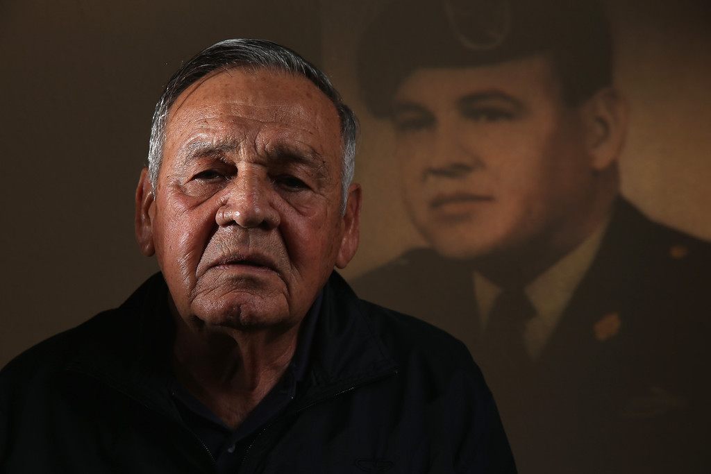 . U.S. Army Sergeant First Class Jose Rodela, seen with an image of him in his uniform projected on the wall behind him, will receive the Medal of Honor on March 18th for his actions while serving in the Vietnam war on March 11, 2014 in San Antonio, Texas.   (Photo by Joe Raedle/Getty Images)