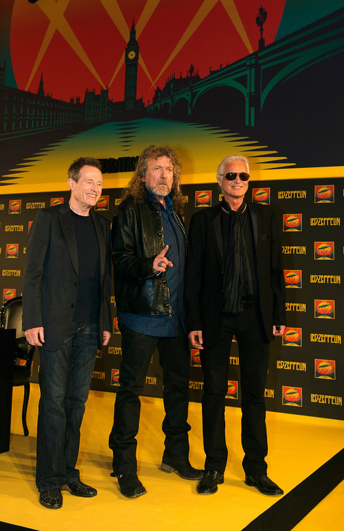 . British rock band Led Zeppelin\'s (L-R) John Paul Jones, Robert Plant and Jimmy Page pose at a press conference to announce the release of a video recording of their one-off 2007 concert in London on September 21, 2012. The legendary British rock band Led Zeppelin disbanded in 1980 after the unexpected death of drummer John Bonham. For the next 27 years the surviving three members pursued solo projects coming together for a reunion at a one off concert in London in 2007. An official video recording of that concert will be released next month in multiple formats.   ADRIAN DENNIS/AFP/GettyImages
