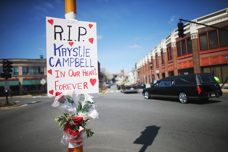 . The funeral procession passes a sign for 29-year-old Krystle Campbell, who was one of three people killed in the Boston Marathon bombings, who was one of three people killed in the Boston Marathon bombings, on April 22, 2013 in Medford, Massachusetts. The 29-year-old restaurant manager, raised in Medford, Massachusetts, Massachusetts, was killed April 15, in the blasts at the finish line of the Boston Marathon. Massachusetts Gov. Deval Patrick has asked residents to observe a moment of silence at the time of the first explosion at 2:50 p.m. this afternoon.  (Photo by Mario Tama/Getty Images)