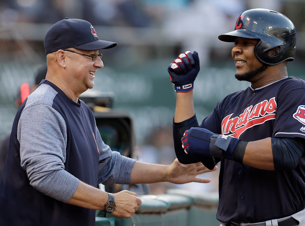 . Cleveland Indians\' Edwin Encarnacion, right, is congratulated by manager Terry Francona after scoring against the Oakland Athletics in the sixth inning of a baseball game Saturday, July 15, 2017, in Oakland, Calif. Encarnacion scored on a ground-out by Indians\' Carlos Santana. (AP Photo/Ben Margot)