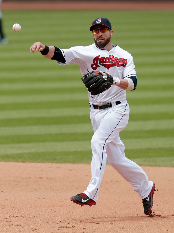 . Cleveland Indians� Jason Kipnis throws out Detroit Tigers\' Andrew Romine in the fifth inning of a baseball game, Wednesday, June 24, 2015, in Cleveland. (AP Photo/Tony Dejak)