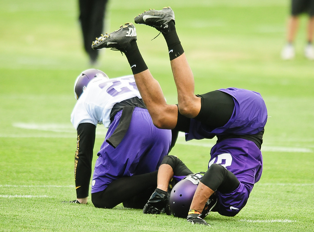 . Minnesota Vikings wide receiver Rodney Smith rolls over after missing a pass at Vikings training camp in Mankato, Minn., on Friday, July 26, 2013. (Pioneer Press: Ben Garvin)