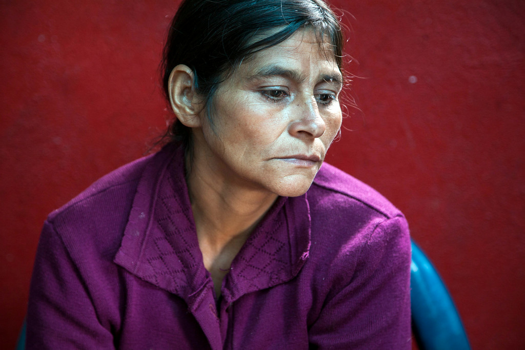. Cipriana Juarez Diaz, mother of Gilberto Francisco Ramos Juarez, a Guatemalan boy whose decomposed body was found in the Rio Grande Valley of South Texas, listens to her husband talk, during an interview at their home in San Jose Las Flores, in the northern Cuchumatanes mountains of Guatemala, Tuesday, July 1, 2014. Juarez Diaz said that she begged her son not set out on the dangerous journey from their modest cinder block- and sheet-metal home high in the northern Guatemalan mountains. (AP Photo/Luis Soto)
