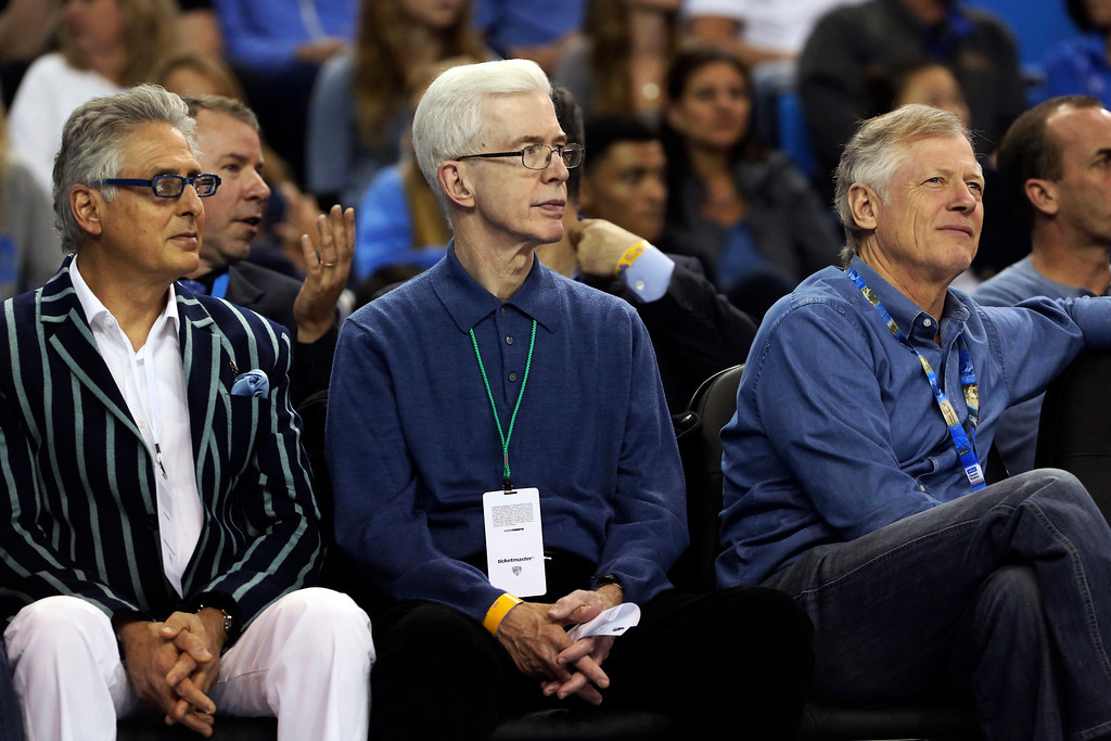 . Former California Gov. Gray Davis, center, watches an NCAA college basketball game between UCLA and Oregon State in Los Angeles, Thursday, Jan. 17, 2013. UCLA won 74-64. (AP Photo/Reed Saxon)