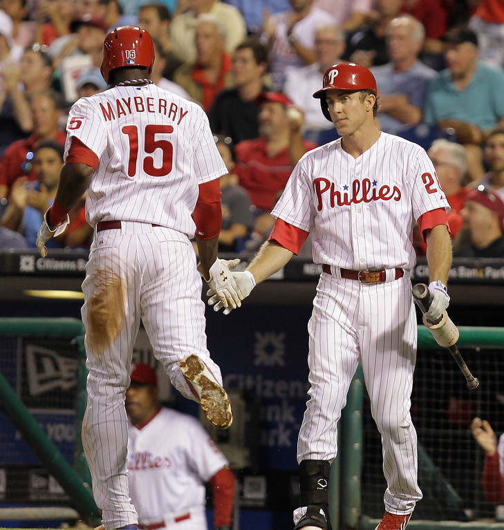 . Philadelphia Phillies\' John Mayberry Jr. is congratulated by Chase Utley after scoring a run in the third inning against the Colorado Rockies in a baseball game, Tuesday, Aug. 20, 2013, in Philadelphia. (AP Photo/Laurence Kesterson)