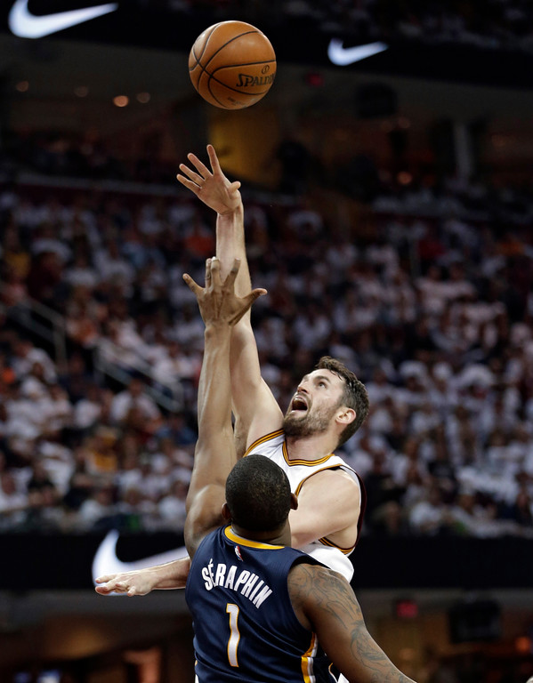 . Cleveland Cavaliers\' Kevin Love shoots over Indiana Pacers\' Kevin Seraphin, from France, in the first half in Game 1 of a first-round NBA basketball playoff series, Saturday, April 15, 2017, in Cleveland. (AP Photo/Tony Dejak)