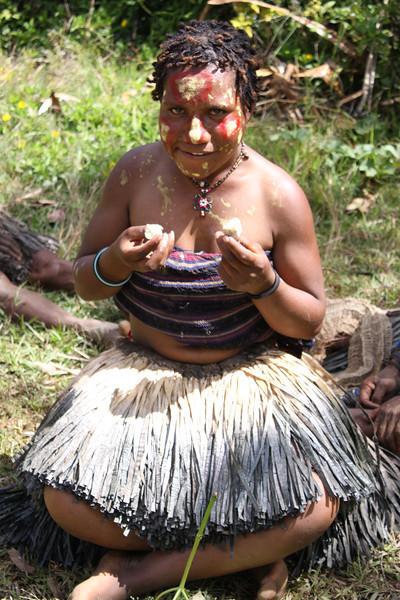 Hela woman eating sweet potato