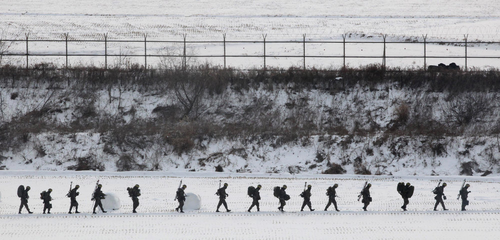 . South Korean army soldiers  move during an exercise near the demilitarized zone of Panmunjom in Paju, South Korea, Tuesday, Feb. 12, 2013.  North Korea said it successfully detonated a miniaturized nuclear device at a northeastern test site Tuesday, defying U.N. Security Council orders to shut down atomic activity or face more sanctions and international isolation. (AP Photo/Ahn Young-joon)