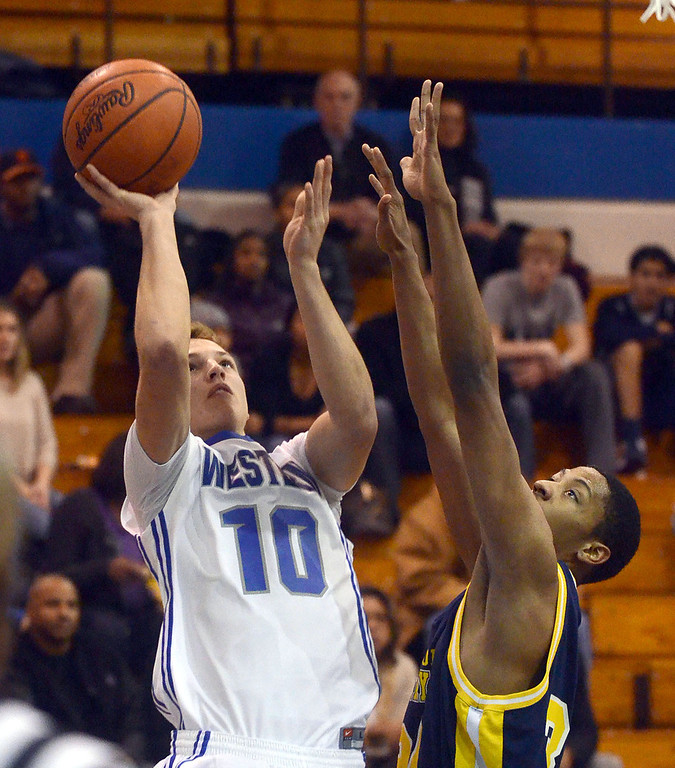 . Walled Lake Western\'s #10 David Walczyk shoots over the outstretched arms of Detroit Country Day\'s #34 DeShawn Lewis during their game at Walled Lake Western High School, Friday December 13, 2013. Western went on to win the game 73-69. (Vaughn Gurganian-The Oakland Press)