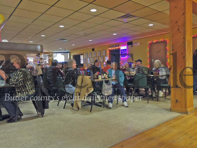 Patrons of the Beer Garden Sports Bar and Grille watch as goods are brought in to be auctioned off for the benefit of a Brady Township woman that was attacked by three dogs earlier this month.