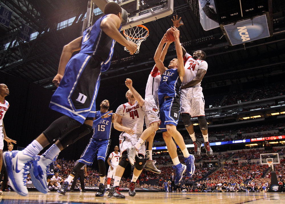 . Mason Plumlee #5 of the Duke Blue Devils attempts a shot in the first half against Montrezl Harrell #24 of the Louisville Cardinals during the Midwest Regional Final round of the 2013 NCAA Men\'s Basketball Tournament at Lucas Oil Stadium on March 31, 2013 in Indianapolis, Indiana.  (Photo by Streeter Lecka/Getty Images)