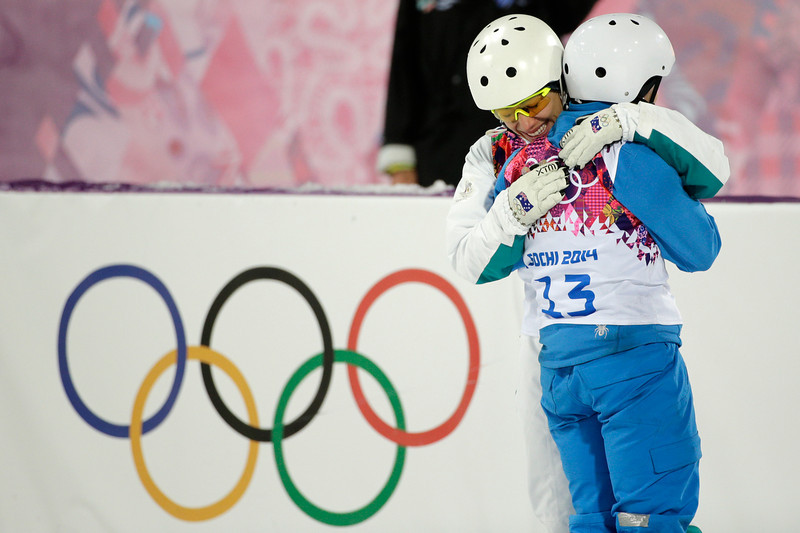 . Women\'s freestyle skiing aerials gold medalist Alla Tsuper(13), of Belarus, is hugged by bronze medalist Lydia Lassila, of Australia, at the Rosa Khutor Extreme Park, at the 2014 Winter Olympics, Friday, Feb. 14, 2014, in Krasnaya Polyana, Russia. (AP Photo/Jae C. Hong)