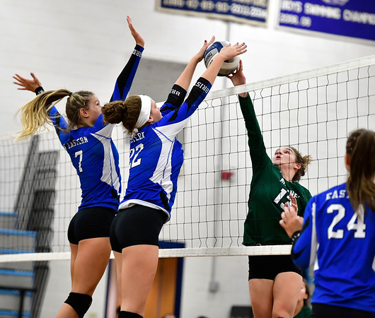 10/2/2019 Mike Orazzi | Staff Bristol Eastern's Zoe Lowe (7) and Hannah Webber (22) at the net with Maloney's Grace Massicotte (13) during a win over Maloney on Wednesday.