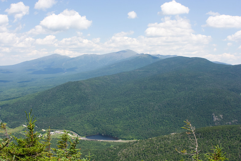 Saco Lake at the top of Crawford Notch.  Saco Lake and south drains to the Gulf of Maine, and north drains via the Connecticut River.  Behind Mt. Adams, Mt. Jefferson, Mt. Washington, Mt. Monroe, Mt. Eisenhower, Mt. Pierce.