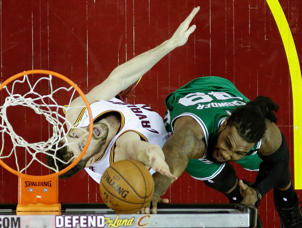 . Boston Celtics\' Jae Crowder (99) shoots against Cleveland Cavaliers\' Kevin Love (0) during the first half of Game 4 of the NBA basketball Eastern Conference finals, Tuesday, May 23, 2017, in Cleveland. (AP Photo/Tony Dejak)