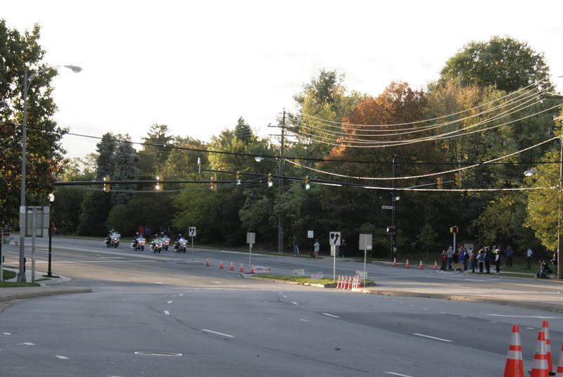 Motorcycles escort runners