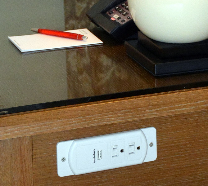 Beside outlet with USB port on the side of the nightstand at the Taconic Hotel in Manchester, VT