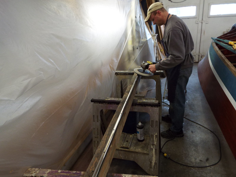 Polishing the old stainless steel trim after all the defects were removed.