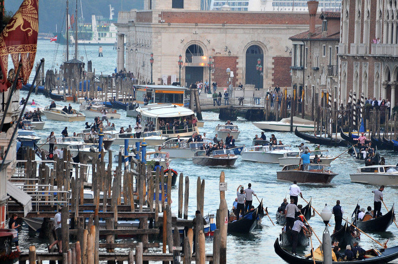 . The boat taking George Clooney to his wedding with Amal Alamuddin, is surrounded by photographers and televisions boats as they parade Canal Grande on their way to the Aman hotel in Venice, Italy, Saturday, Sept. 27, 2014. (AP Photo/Luigi Costantini)