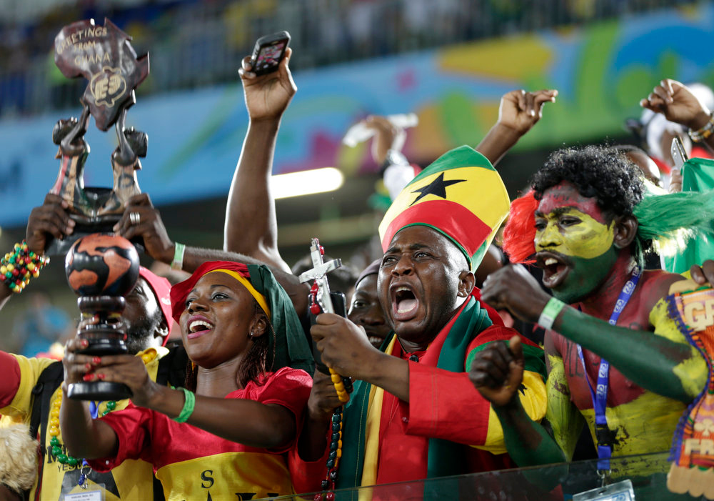 Description of . Ghana fans react before the group G World Cup soccer match between Ghana and the United States at the Arena das Dunas in Natal, Brazil, Monday, June 16, 2014.  (AP Photo/Dolores Ochoa)
