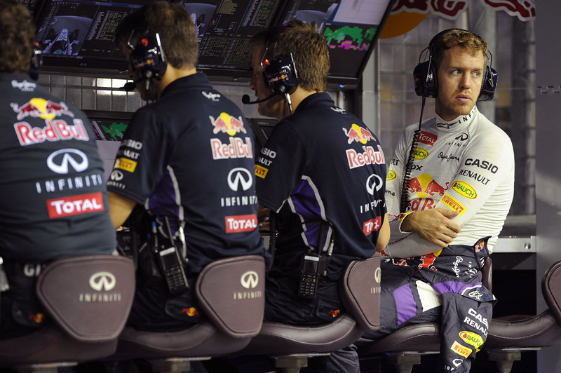 . Red Bull Racing team german driver Sebastian Vettel (R) waits in the control station prior to take off in the second practice session of the Formula One Singapore Grand Prix at the Marina Bay Street circuit on September 19, 2014. The Singapore Grand Prix will take place on September 21.  ROMEO GACAD/AFP/Getty Images