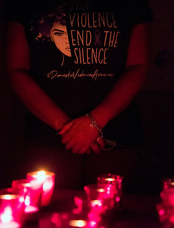 10/02/19 Wesley Bunnell | StaffrrThe Prudence Crandall Center held a candlelight vigil in remembrance of victims of domestic violence on Wednesday night. Prudence Crandall Shelter Manager Lily DeJesus wears a t shirt speaking out against domestic violence after lighting candles in honor of victims lost to domestic violence in Connecticut.