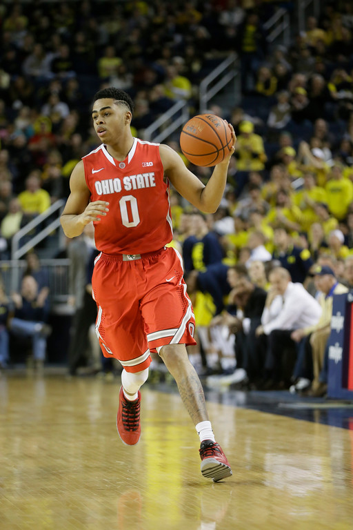 . Ohio State guard D\'Angelo Russell brings the ball up court during the second half of an NCAA college basketball game against Michigan, Sunday, Feb. 22, 2015 in Ann Arbor, Mich. Michigan defeated Ohio State 64-57. (AP Photo/Carlos Osorio)
