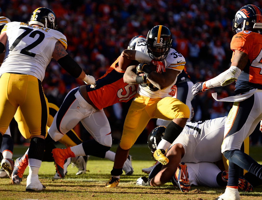 . Pittsburgh Steelers running back Fitzgerald Toussaint (33) rushes in for a touchdown on Denver Broncos middle linebacker Todd Davis (51) during the first quarter January 17, 2016 in the Divisional Round Playoff game at Sports Authority Field at Mile High Stadium. (Photo By Helen Richardson/The Denver Post)