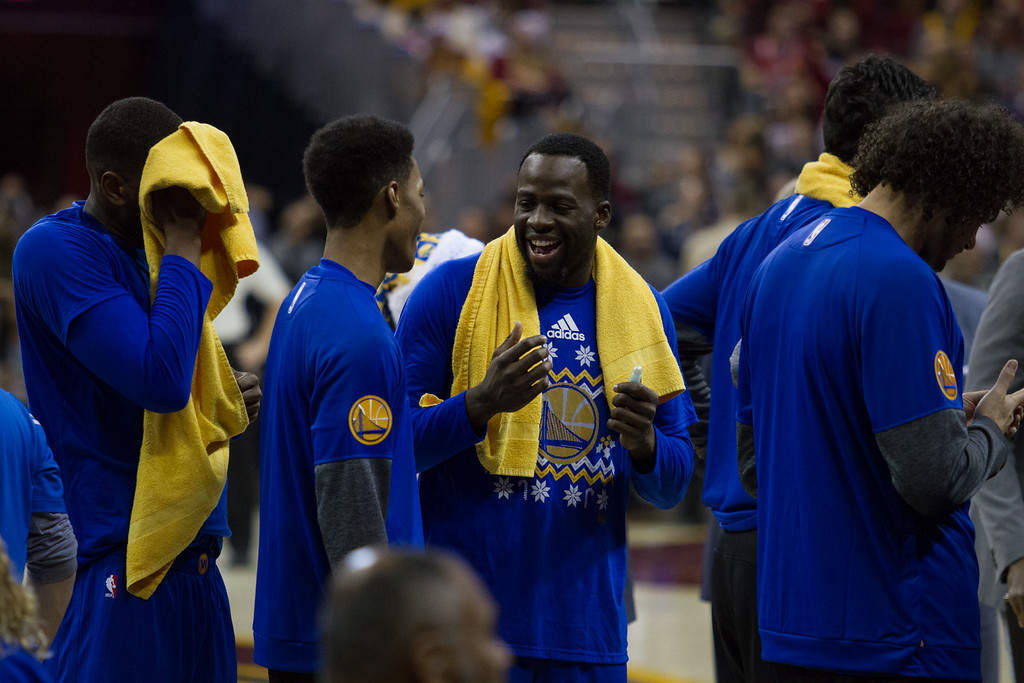. The Golden State Warriors\' Draymond Green smiles during a time out during an NBA game at the Quicken Loans Arena on Christmas day.  The Cavs defeated the Warriors 109-108.  Michael Johnson - The News Herald