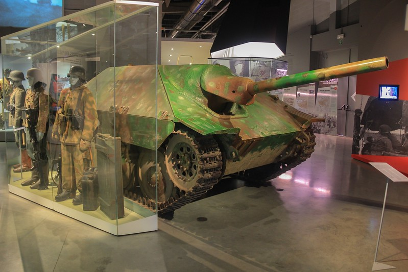 A small German tank killer known as a G-13 Hetzer. Only 50 were made, and 20 of them saw action in the Battle of the Bulge. Its 160 H.P. engine had to be HAND-cranked! Imagine doing that to an engine big enough to throw a 15  ton armored, tracked vehicle around.