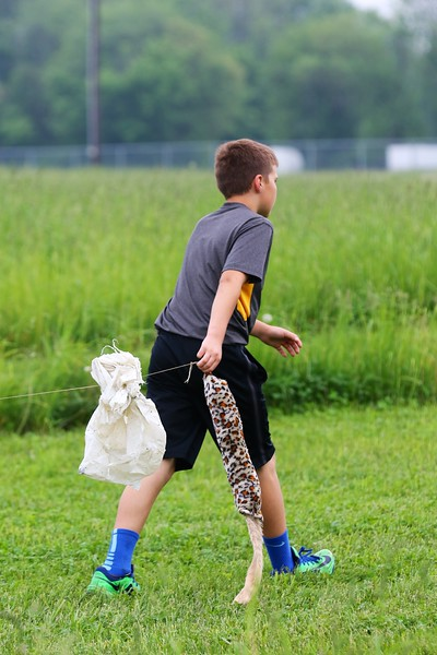 Lure Lad Trevor Lauck hauls the lure back to the starting box after each race..jpg