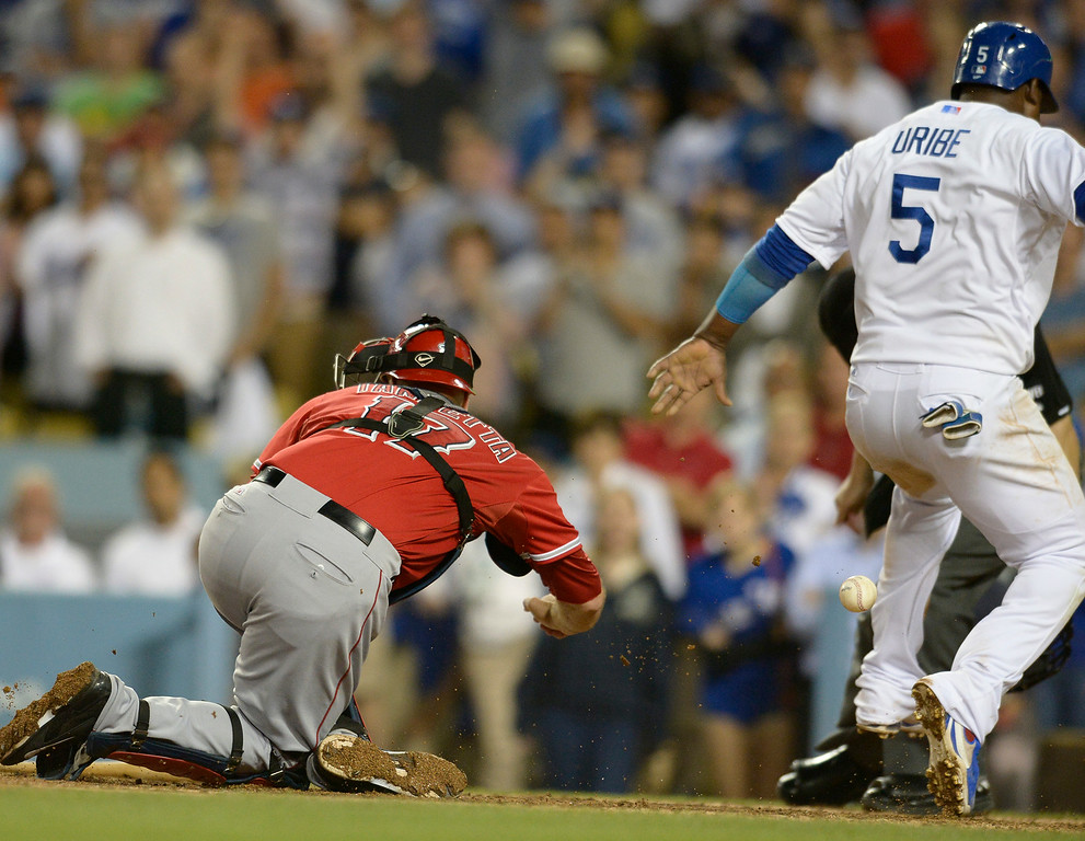 . Juan Uribe scores on an Andre Ethier single in the 9th inning to win the game. The Dodgers defeated the Angels 5-4. Los Angeles, CA. 8/5/2014(Photo by John McCoy Daily News)