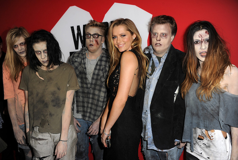 ". Actress Teresa Palmer and zombies arrive for the Los Angeles premiere of Summit Entertainment\'s ""Warm Bodies\"" at ArcLight Cinemas Cinerama Dome on January 29, 2013 in Hollywood, California.  (Photo by Kevin Winter/Getty Images)"