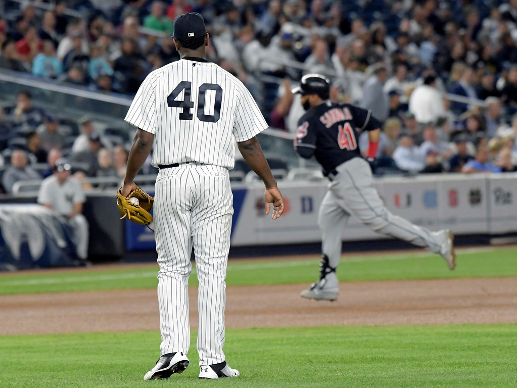 . Cleveland Indians\' Carlos Santana rounds the bases with a home run as New York Yankees pitcher Luis Severino (40) looks on during the seventh inning of a baseball game Monday, Aug. 28, 2017, at Yankee Stadium in New York. (AP Photo/Bill Kostroun)