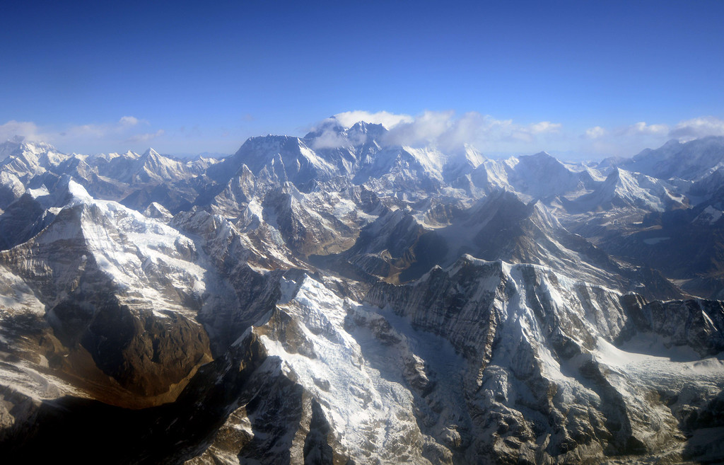 . (FILES) In this photograph taken from an aircraft on April 3, 2013,  an aerial view of Mount Everest (C) and The Himalayan mountain range, some 140kms (87 miles) north-east of Kathmandu can been seen.  At least nine Nepalese climbing guides have been killed and five others are missing after an avalanche struck Mount Everest early April 18, 2014, officials said, in the worst accident to hit the world\'s highest peak. PRAKASH MATHEMA/AFP/Getty Images