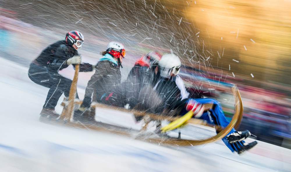 . A hornsled team races into the finishing area in Garmisch-Partenkirchen, Germany, 06 January 2014. About 3,000 spectators attended the traditional hornsled race on Epiphany.  EPA/Marc Mueller